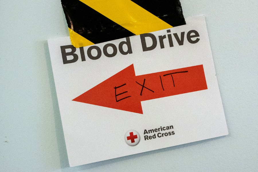 A sign lets donors know where the exit is during a blood drive at the Cheshire Masonic Temple Lodge in Cheshire on Friday, September 11, 2020. Aaron Flaum, Record-Journal