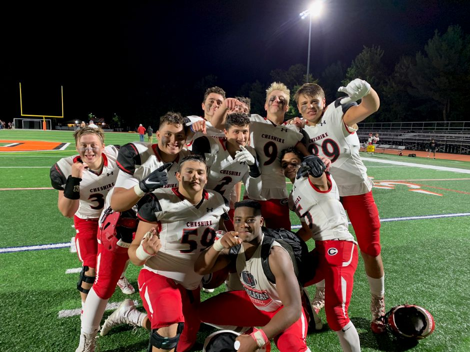 Cheshire Rams celebrate after the football team won 24-12 at Shelton. Photo taken by Greg Lederer/Cheshire Herald.