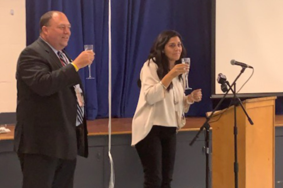 Mariah Melendez/Cheshire Herald – Cheshire Superintendent of Schools Jeff Solan and Norton School Principal Kelly Grillo toast faculty and staff for their hardwork during a Sept. 24 ceremony to announce the school's designation as a National Blue Ribbon School honoree.