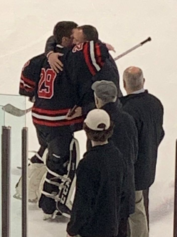 Nick Mongillo embraces CHS ice hockey head coach Anthony Giusto after being announced as the Greg Schena/Mark Whitlock Award winner. Photo taken by Greg Lederer/Cheshire Herald.