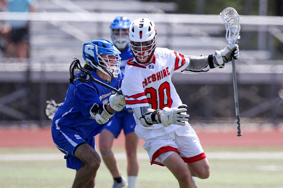 CHS boys' lacrosse senior co-captain Brian Bouwman tallied a hat trick and two assists in Saturday's 17-6 opening win over Southington. Photo taken by James Brandolini/Cheshire Herald.