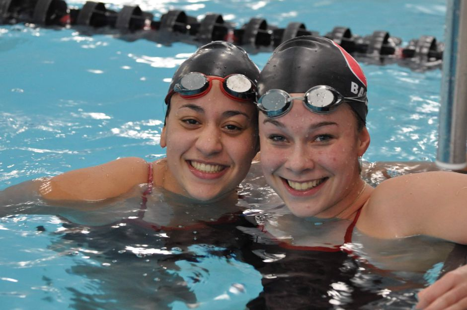 From left, Bella Tejeda and Mary Barto have grown up swimming together in Cheshire. Photo courtesy of Shari Grayson.