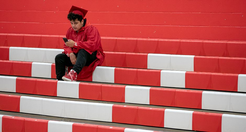Dave Zajac/Record-JournalDave Zajac – Graduate Dustin Ramos, 18, shown before graduation ceremonies began in 2019 for Cheshire High School.