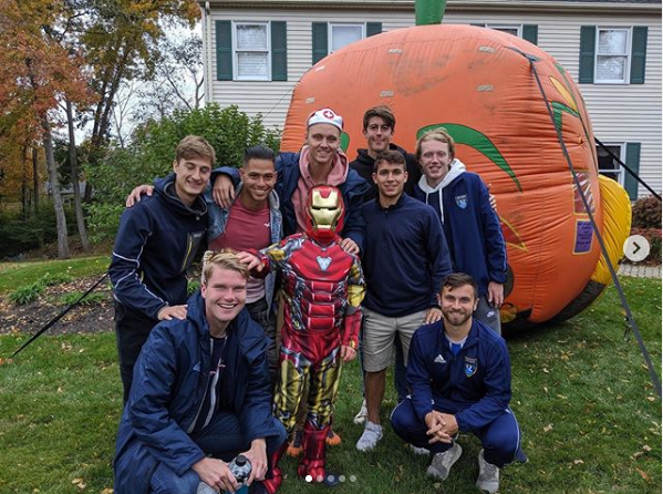 Submitted photo – The Mens QU Soccer team at Dodd Middle School Best Buddies Halloween Party with Sam Hayden.