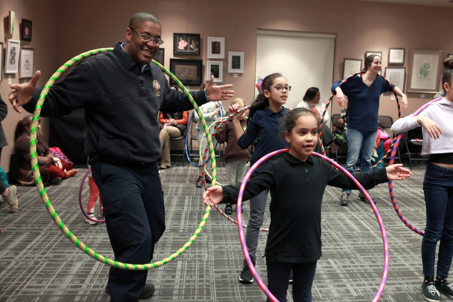 "Tracey Harrington/Cheshire Herald - It was a family night out for Jermaine, Elyse and Amyra Atkinson, as the trio ""hooped"" it up at the Hula Hoop event on Friday, Jan. 24, at the Cheshire Library."