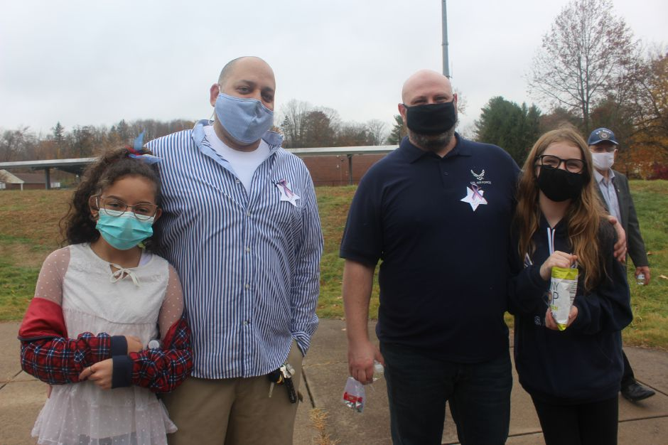 Mariah Melendez/Cheshire Herald-  Veteran Glenn Felton of the US Army (left) and Veteran Mark Minton (right) of the US Air Force with their daughters at the Highland Elementary School Veterans Day celebration.