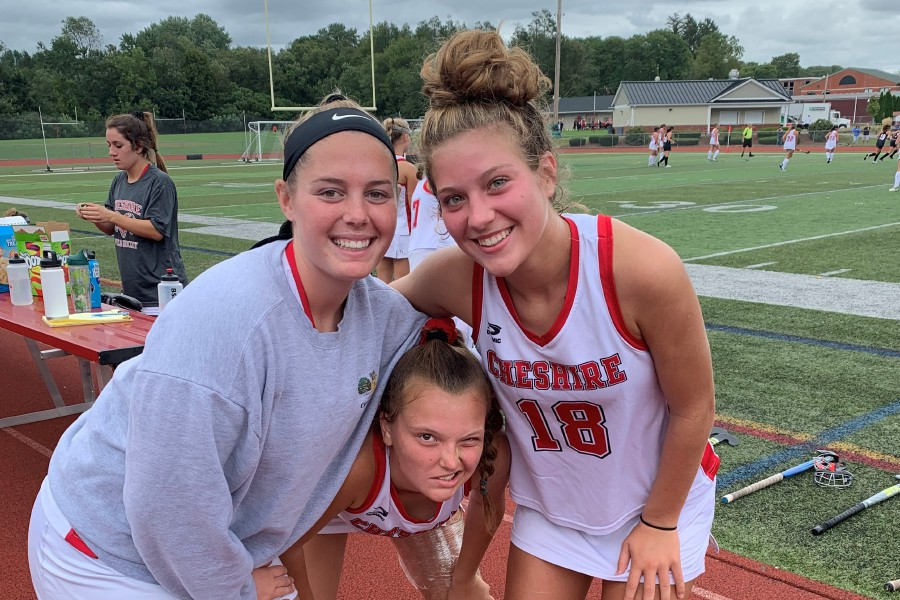 From left, senior Sophie Kurtz, senior co-captain Kiley Jackson, and junior Raegan Bailey pose after CHS field hockey played New Canaan. Photo taken by Greg Lederer/Cheshire Herald.